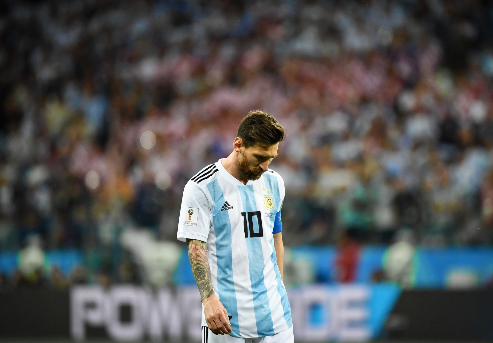 c65103c42 There have been few images more powerful at this summer s World Cup than  that of Lionel Messi